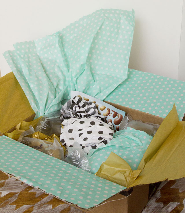 Giving the gift of an experience and mailing a wrapped package - Tissue stuffed - @hipandsimple