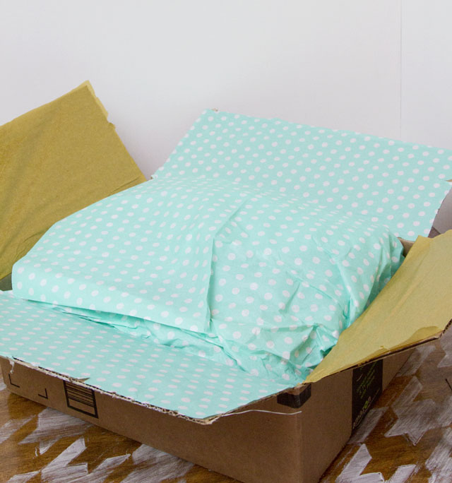 Giving the gift of an experience and mailing a wrapped package - Tissue wrapped - @hipandsimple