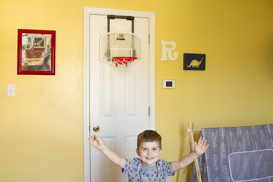 Son excited to show off his new room